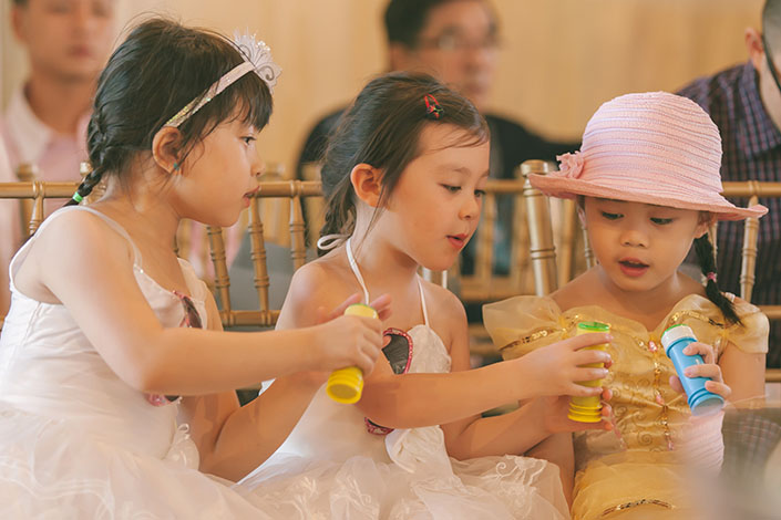 Little girls playing with bubbles