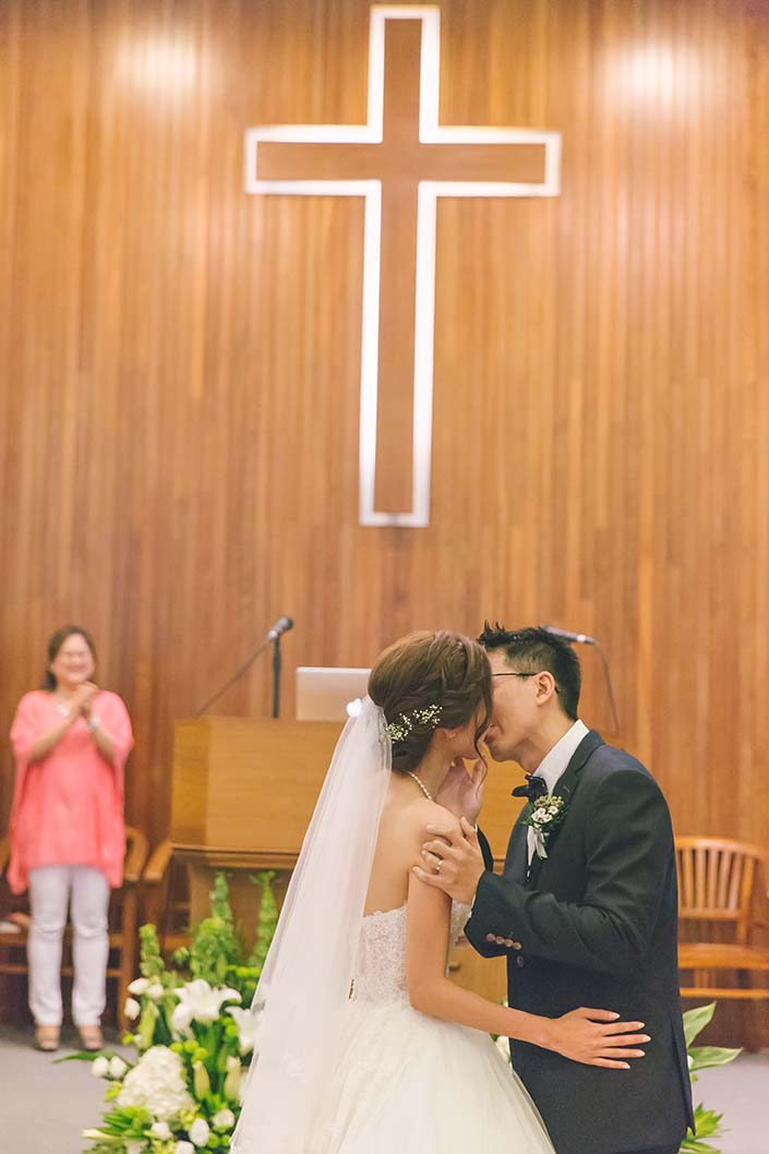 Singapore Wedding Day Photography Kiss at Carmel Presbyterian Church