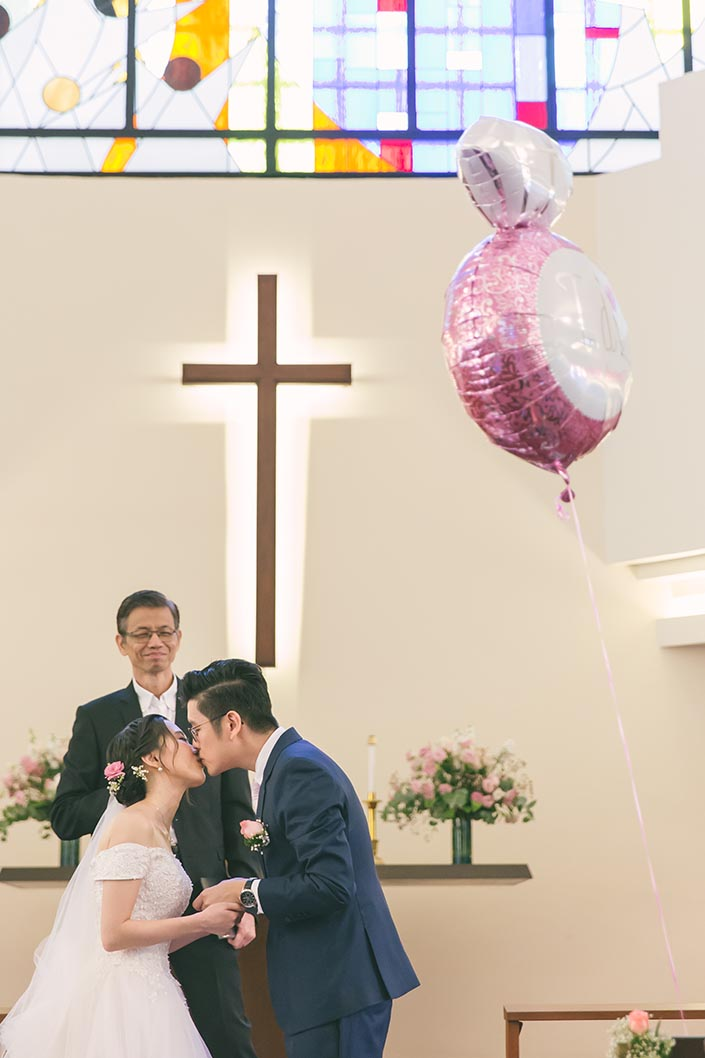 Singapore Actual Wedding Day Church Photography at Bedok Lutheran Church (Kissing the bride)